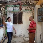Mohamad explains Electric Showers to Odeh - Burj El Barajneh Refugee Camp